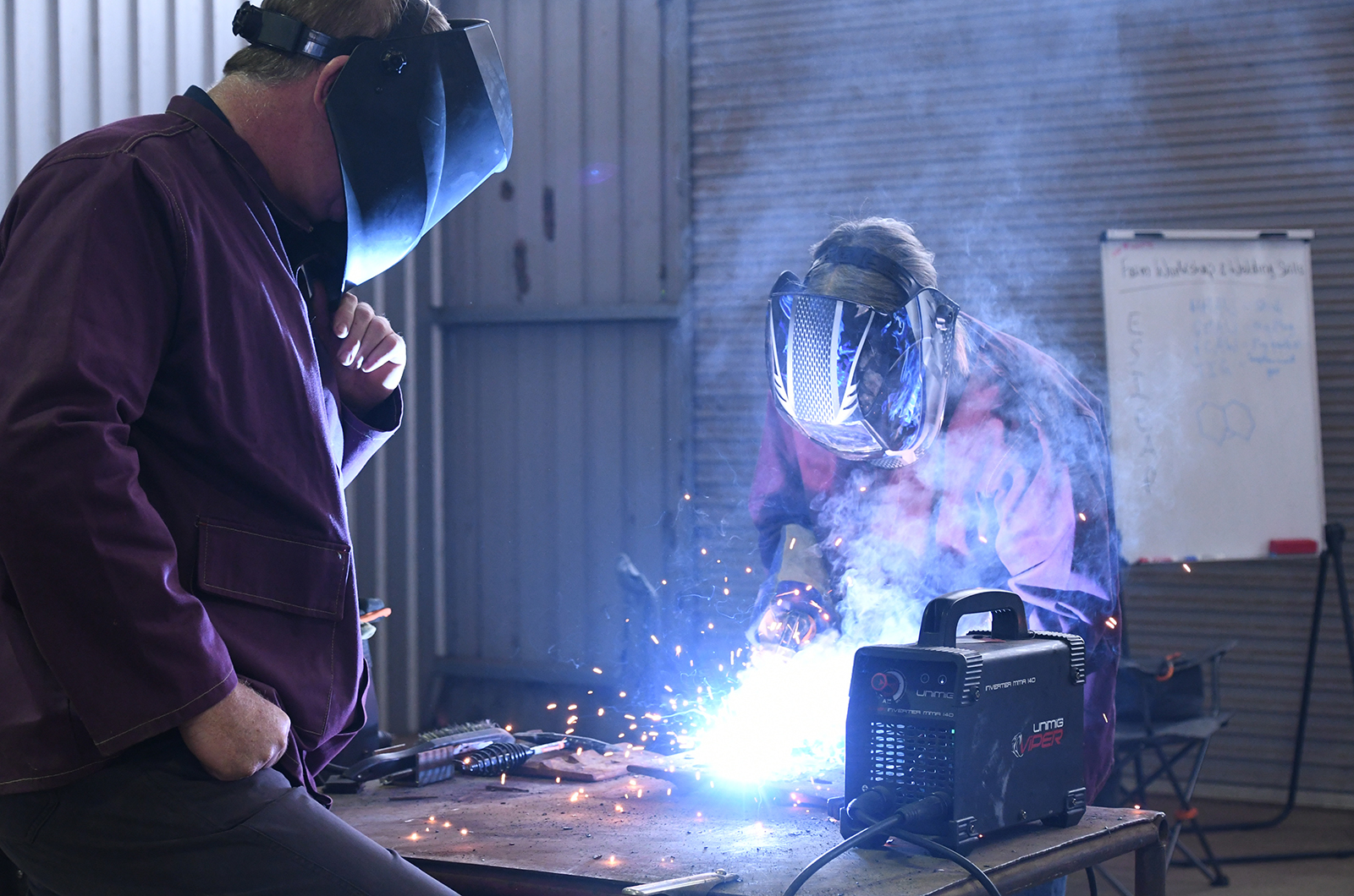 Student welding under supervision
